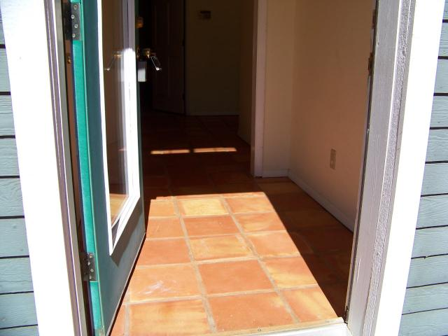 Entry with Teracotta style tile.